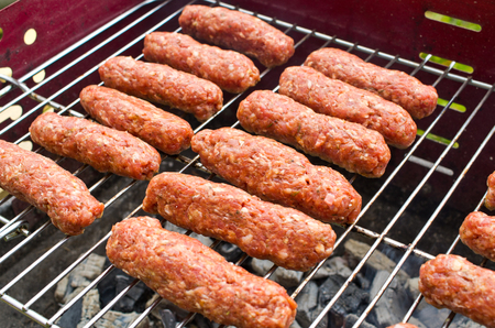 Delicious cevapi on the BBQ photo