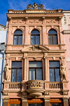 tenement: Old tenement house with statues Editorial