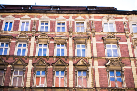 Old, made by brick, tenement house wall
