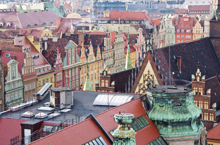 tenement: Roofs of tenement houses in Wroclaws town square - Poland