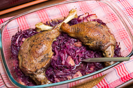 Delicious goose legs baked on red cabbage photo