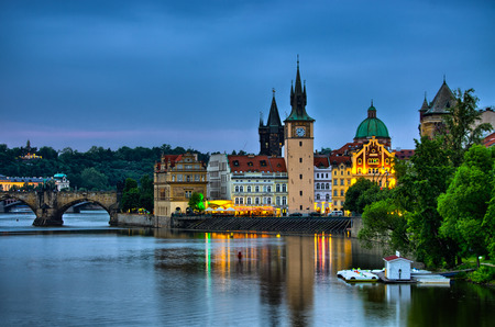 Night view on Vltava river, Charles Bridge and tower in Prague, Czech Republic