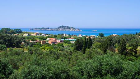 Forest, village and sea - Corfu island, Greece photo