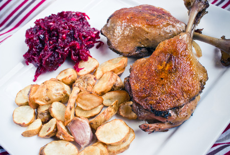canard: Traditional duck legs confit with beetroots and jerusalem artichokes fries
