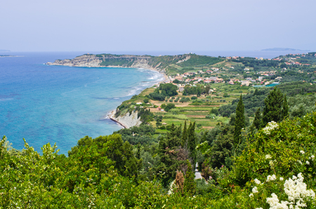 Typical bay with little town Arillas on Corfu, Greece photo