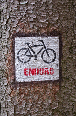 cycler: Cycle Enduro sign on the bark