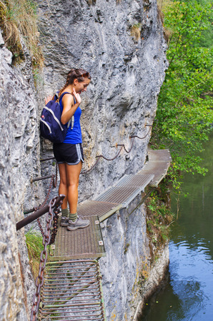 slovak: Young woman on the trail along the Hornad river, Slovak Paradise Stock Photo