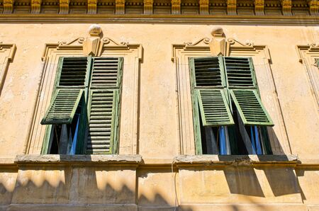 open windows: Two windows with old open shutters