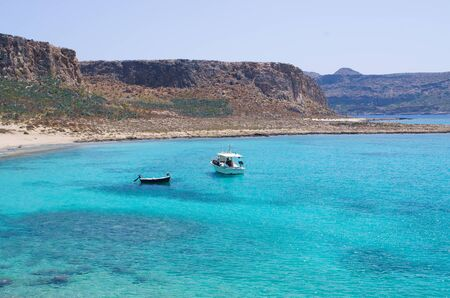 blue lagoon: Boats near Balos beach on Crete - Greece