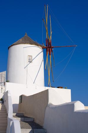 oia: Famous windmill in Oia town - Santorini, Greece