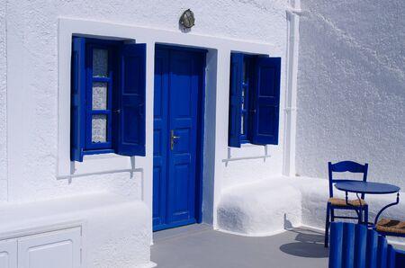 blue door: Blue door and windows on greek island Stock Photo