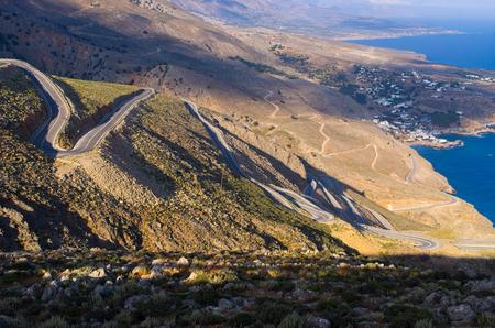 chora: Curvy road near Chora Sfakion on Crete island, Greece Stock Photo