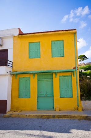 green door: Green door and window in yellow house, Crete, Greece