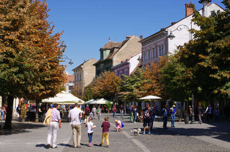 centres: Sibiu, Romania - September 06, 2015: Crowded main street. The town is one of the most important cultural centres of Romania