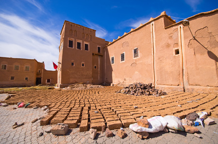 Kasbah and bricks dried on the sun in Ouarzazate, Morocco