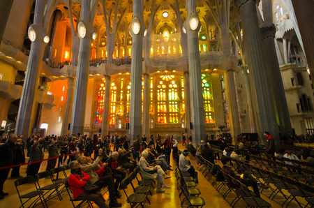 expected: Barcelona, Spain - March 03, 2016: Interior of Sagrada Familia church. Designed by Catalan architect Antoni Gaudi. Building began in 1882 and expected finish date is 2026. Editorial