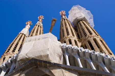 expected: Barcelona, Spain - March 03, 2016: Sagrada Familia church. Designed by Catalan architect Antoni Gaudi. Building began in 1882 and expected finish date is 2026.