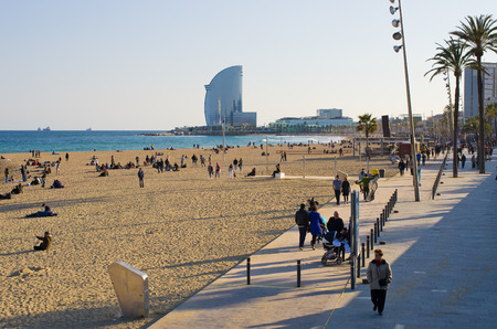 touristy: Barcelona, Spain - March 03, 2016: Barceloneta Beach.  Barcelonas most crowded and most touristy stretch of sand.