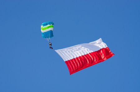aerobatic: Leszno, Poland - June 18, 2016: paratroopers during the air show. Leszno Air Picnic 2016 is annual event that attracts thousands of viewers. Editorial