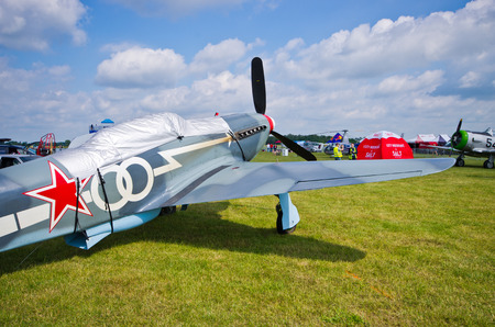 fixed wing aircraft: Leszno, Poland - June 18, 2016: Jak-3 fighter on static display. Leszno Air Picnic 2016. Editorial