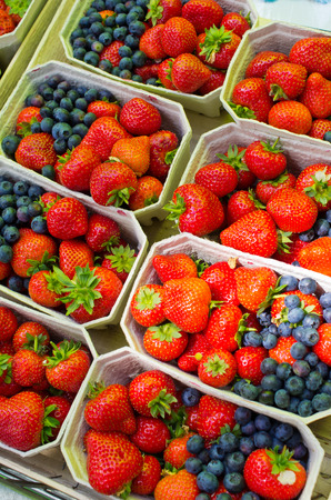 Fresh strawberries and blueberries on the market
