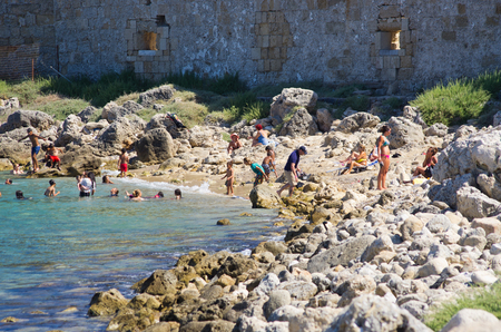 Rhodes, Greece - July 17, 2016: beach. One of famous beaches full of tourists. Editöryel