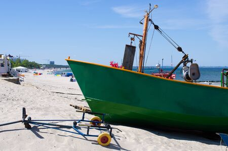 Green boat on the polish beach