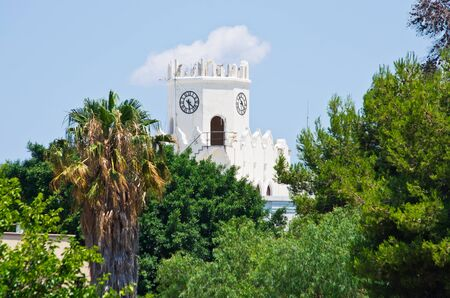 White clock tower in Kos town - Greece