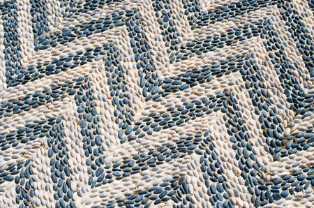 Texture of traditional greek pavement - blue and white