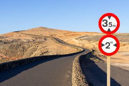 Black road on volcanic island - Lanzarote, Spain Stok Fotoğraf
