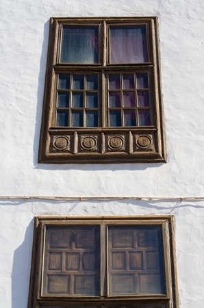 Old brown windows in white wall