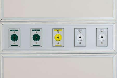 plug socket: Plug socket on the wall of hospital Stock Photo