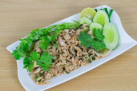 thailand food: Spicy minced pork on wood table, Thai food.