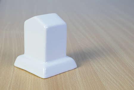milepost: White Milepost models on the wood background Stock Photo