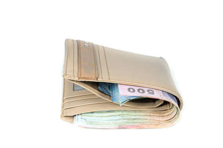 hidden success: wallet with money isolated on white background Stock Photo