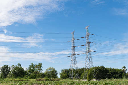 electricity prices: transmission High voltage electricity pylon with blue sky background