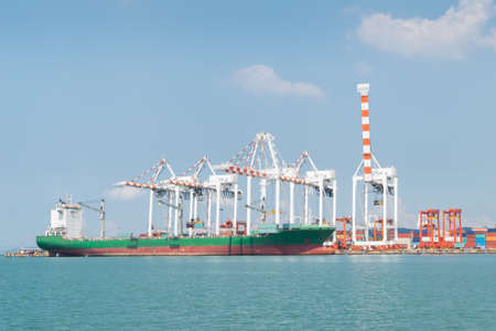 asia: Container ship in asia port while load the job with blue sky