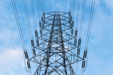 electric grid: transmission High voltage electricity pylon with blue sky background