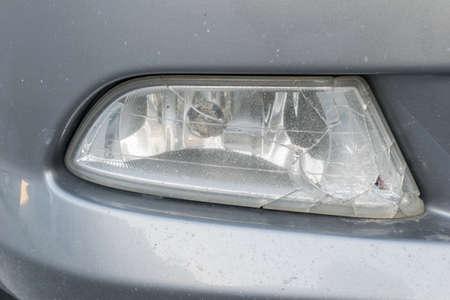 scratched: broken on spotlight or blinker of car Stock Photo
