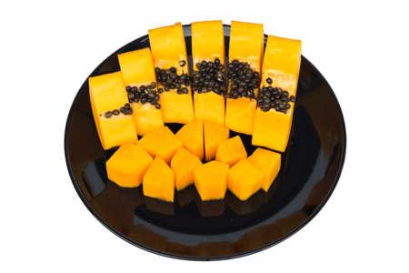 isolated on yellow: ripe papaya with black dish isolated on white background