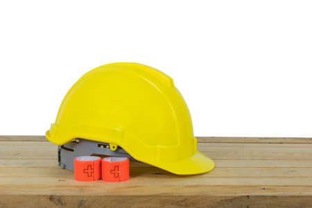 hight tech: Reflective Bracelets or Safety Reflective Wristbands and Yellow Safety Helmet isolated on wood background
