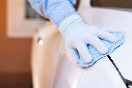Closeup for man polishing cleaning car with microfiber cloth 版權商用圖片