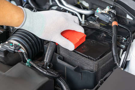 Technician check battery car terminal Reklamní fotografie