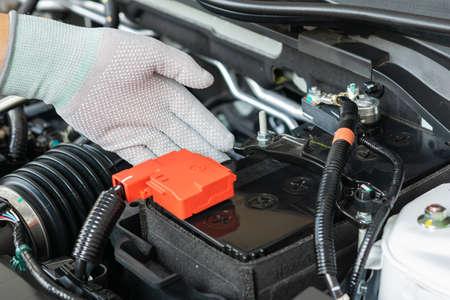 Technician check battery car terminal Foto de archivo