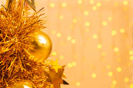 Gold Christmas balls, Gold tree Christmas on a gold bokeh background