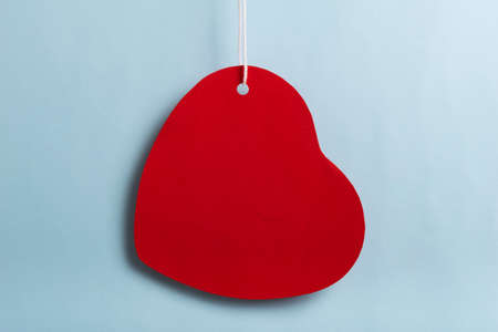 Red heart sales tag. Black friday sale concept. Red heart sale tag color on bule color background with Copy space. Black Friday weekend.