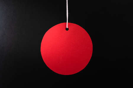 Black friday sale concept. Circle Red sale tag color on the black background with Copy space.