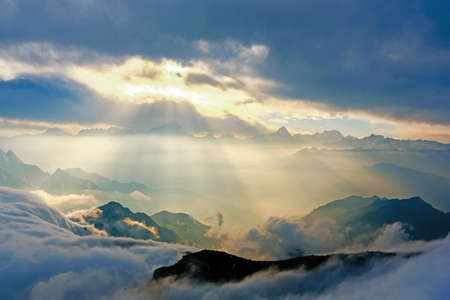 sunshine through clouds on mountain