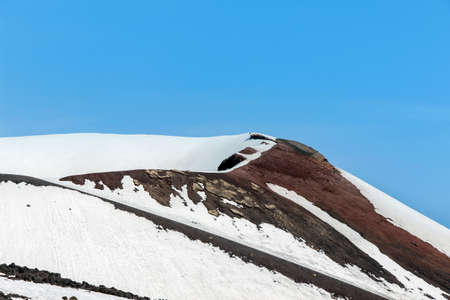 snow on crater on mount etna
