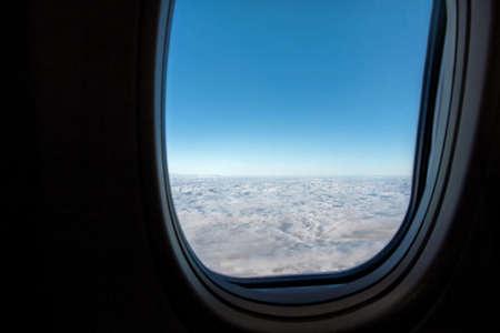 blue sky outside airplane window